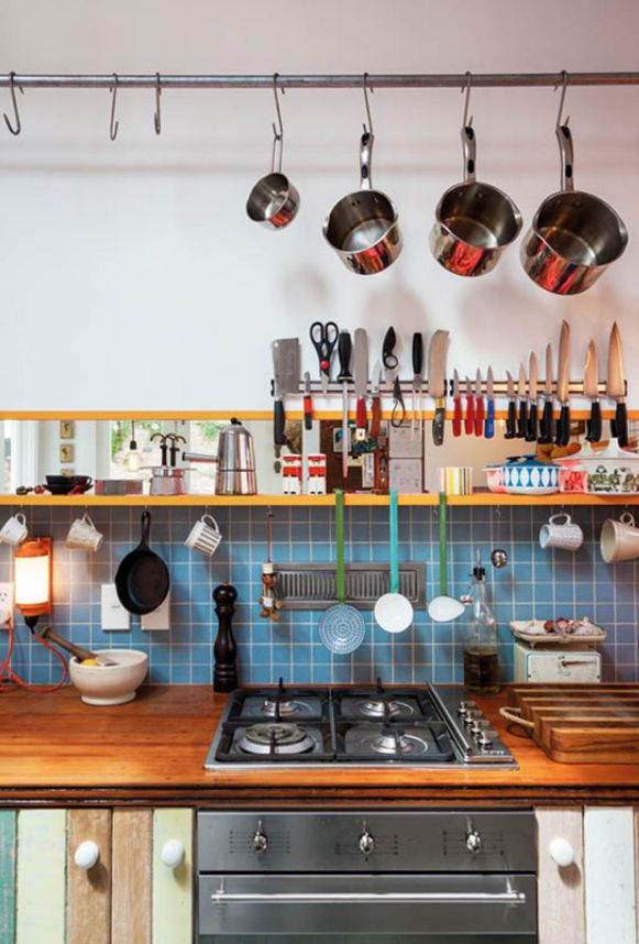 There is a subtle beauty to this simple and practical kitchen design. When form follows function, beautiful things can happen. Love the butcherblock counter!