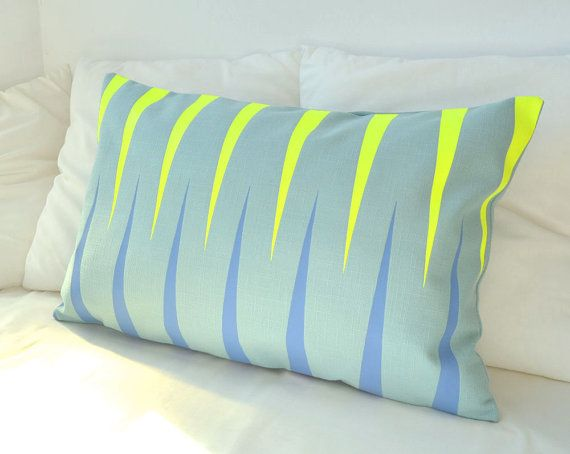 Teal blue modern decorative lumbar pillow with neon by PALEOLOCHIC, €25.00
