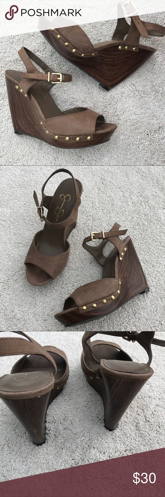 Wedge sling back sandals Wood looking wedge sandals! Super cute! New! Never worn! They do have a very tiny scuff on toe are(would be covered by foot when worn) these where too small for me 😭 Jessica Simpson Shoes Wedges