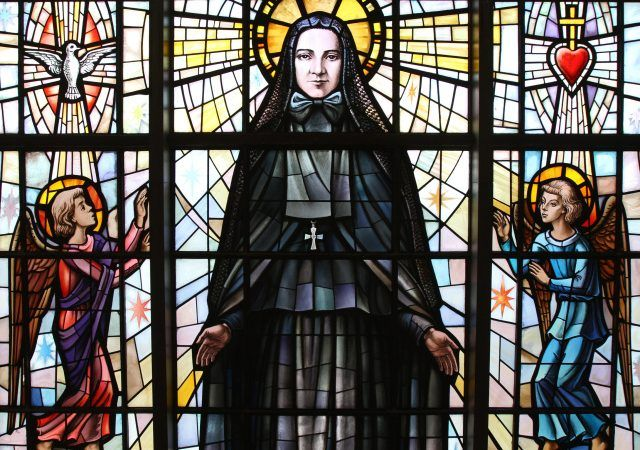 St. Frances Xavier Cabrini depicted in a stained-glass window at the saint's shrine chapel in the Washington Heights section of New York City. Her remains rest in a glass casket under the altar in the shrine. (Credit: CNS file/Gregory A. Shemitz.)