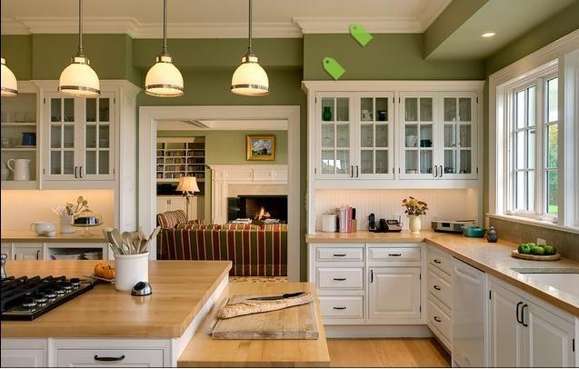 White oak cabinetry, butcher block counters, pretty sage green walls, tile backsplash