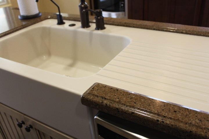 Custom made corian farm sink with drainboard in a hanstone Corian bathroom sinks and countertops