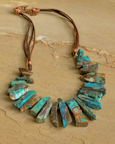 """Blue ocean jasper stick, copper beads and brown leather cord make this statement necklace the perfect accessory for fall. Approximately 22"""" in length. More"""