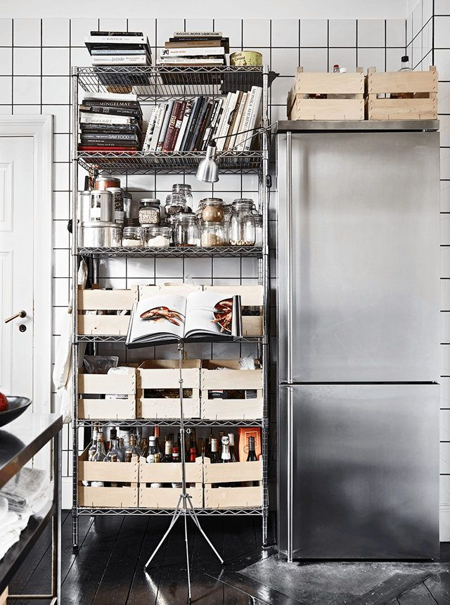 Industrial style shelves and SMEG fridge in the kitchen of a stunning industrial-style home in Lund, Sweden. Credits: Emma Persson Lagerberg / Andrea Papini. Elle Decoration.