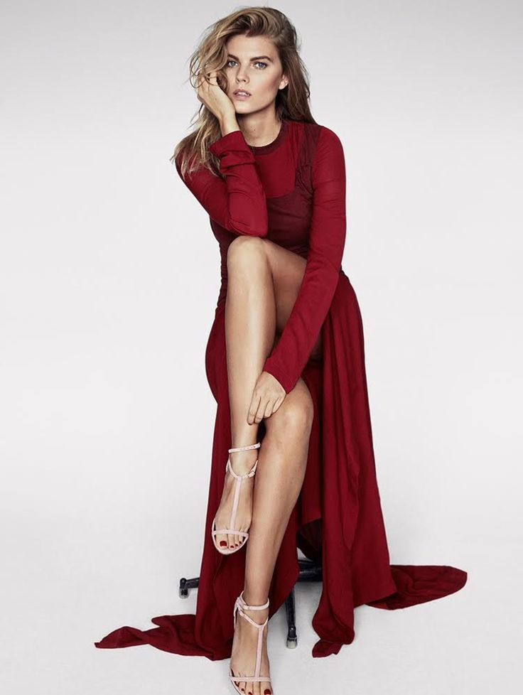 Model Maryna Linchuk poses in red maxi dress with draped fabric