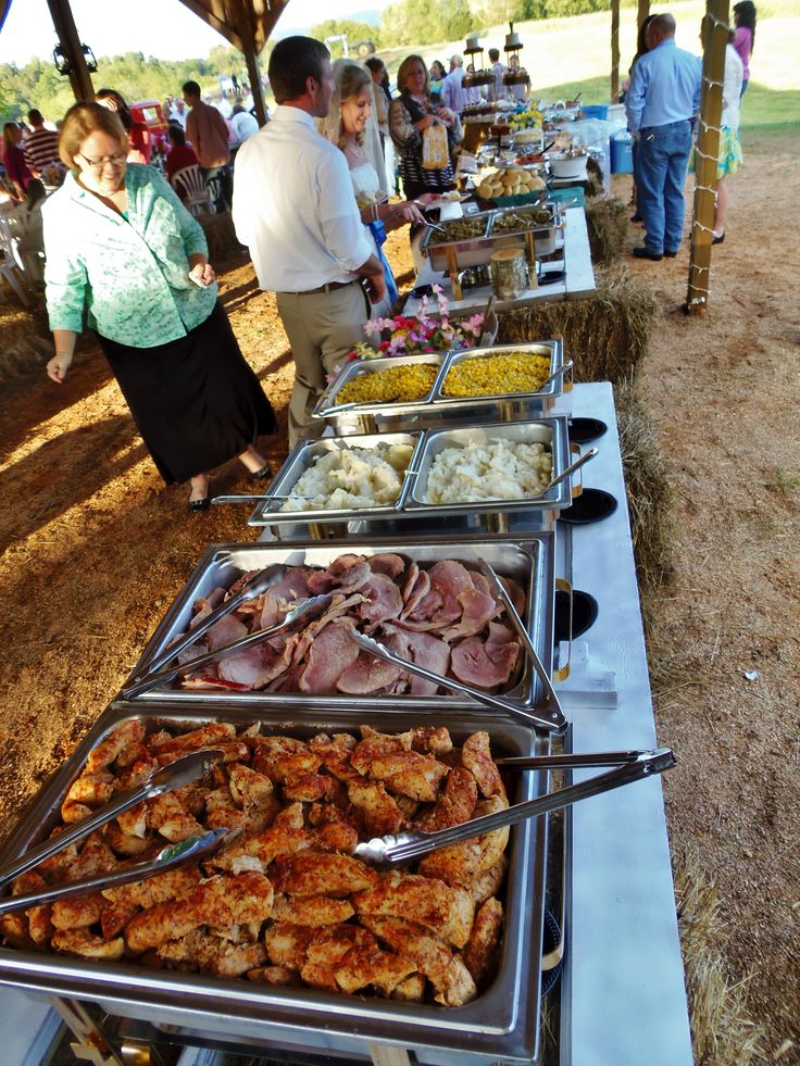 Buffet for outdoor country wedding~ chicken, ham, mashed potatoes, corn, green beans, slaw, rolls.
