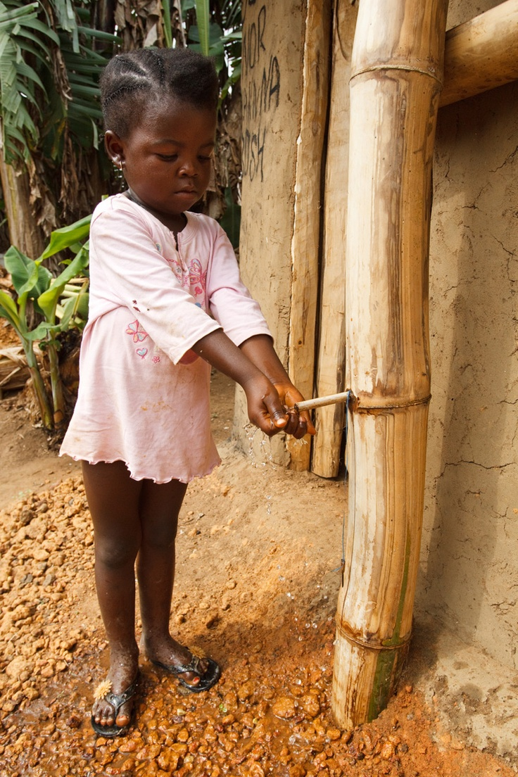 Mariama Fallah is 4 years old. She is washing her hands using a ...