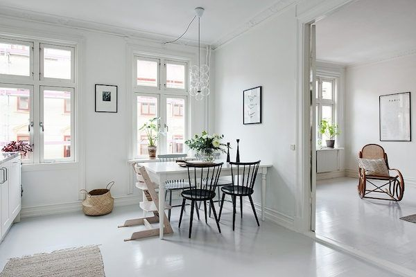 kitchen / dining in a serene white and grey Swedish apartment. Alvhem.