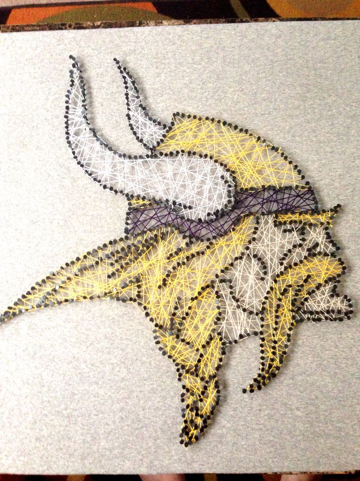 NFL Vikings string art. Made this for my boyfriend for Christmas! I took cork board covered it in fabric and traced the design with nails added string and done! Super easy. (I used the cork instead of wood to not bother my neighbors and it makes the process way quicker!) I do recommend gluing the nails in if they stick out too far.