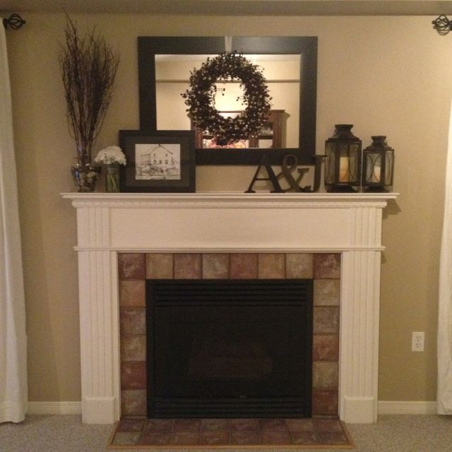 White mantle fireplace and Fire place mantel decor