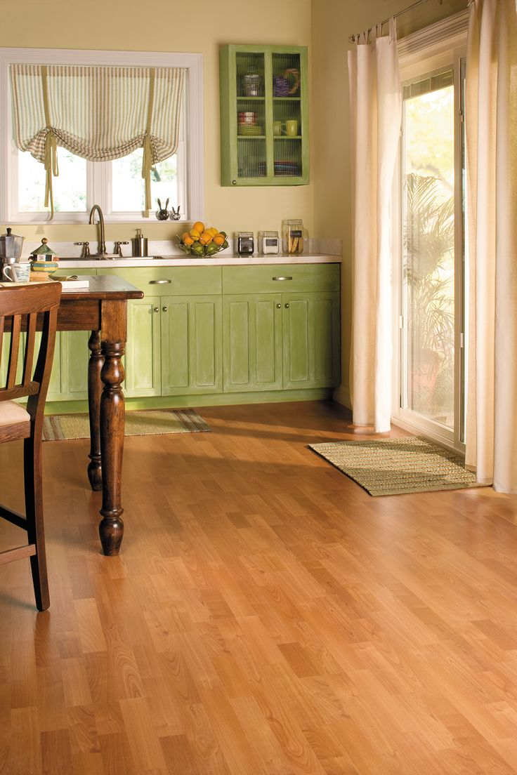 Add warmth to your home with beautiful honey toned floors. Enhanced Cherry 3-Strip Planks from Quick-Step's QS700 Collection.