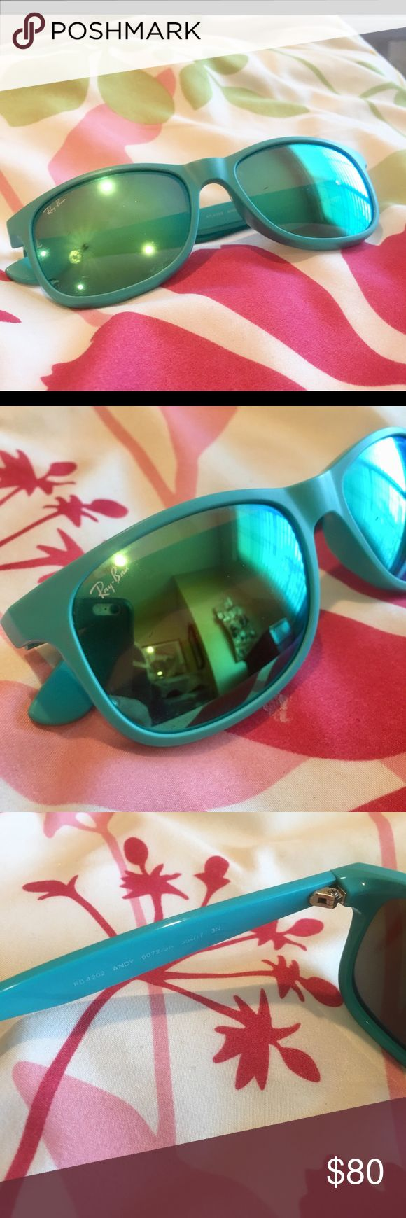 Authentic Ray Ban teal mirrored glasses Authentic Ray Ban teal mirrored glasses. Worn several tones but in great condition. No scratches on lenses. Comes in case but not Ray Ban case. Ray-Ban Accessories Sunglasses