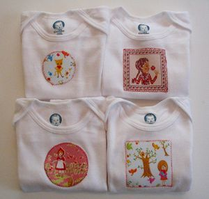 Adhere patches with Heat and Bond Lite to onsie and stitch perimeter for a handmade look. LOVE! and very inexpensive.