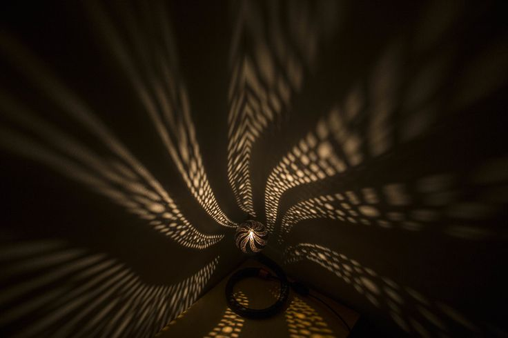 Unique drilled coonut lamp casts a magical glow over your rooms
