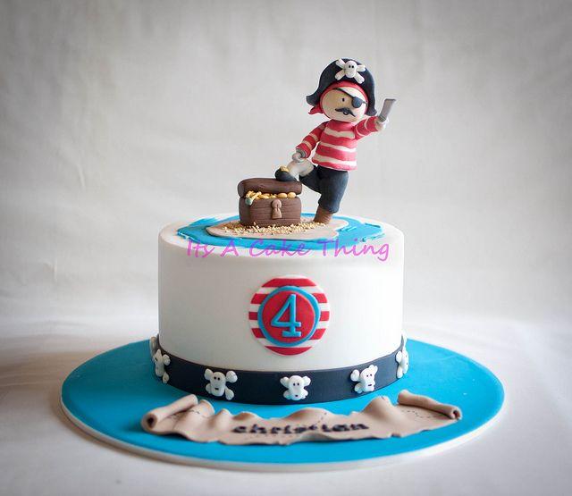 PIRATE PARTY. Un petit pirate rouge sur son île/gâteau.