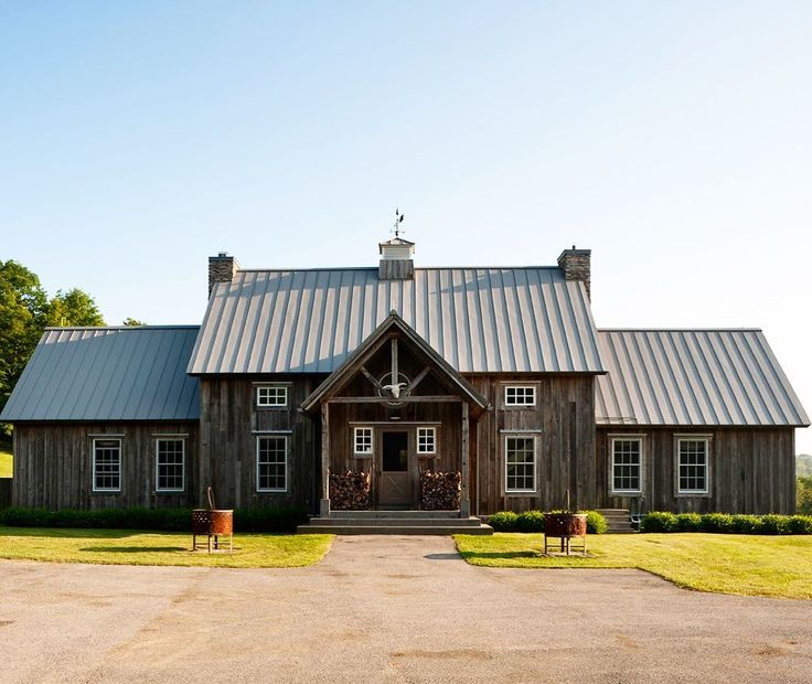 Metal roof on traditional house. Metal roof houses