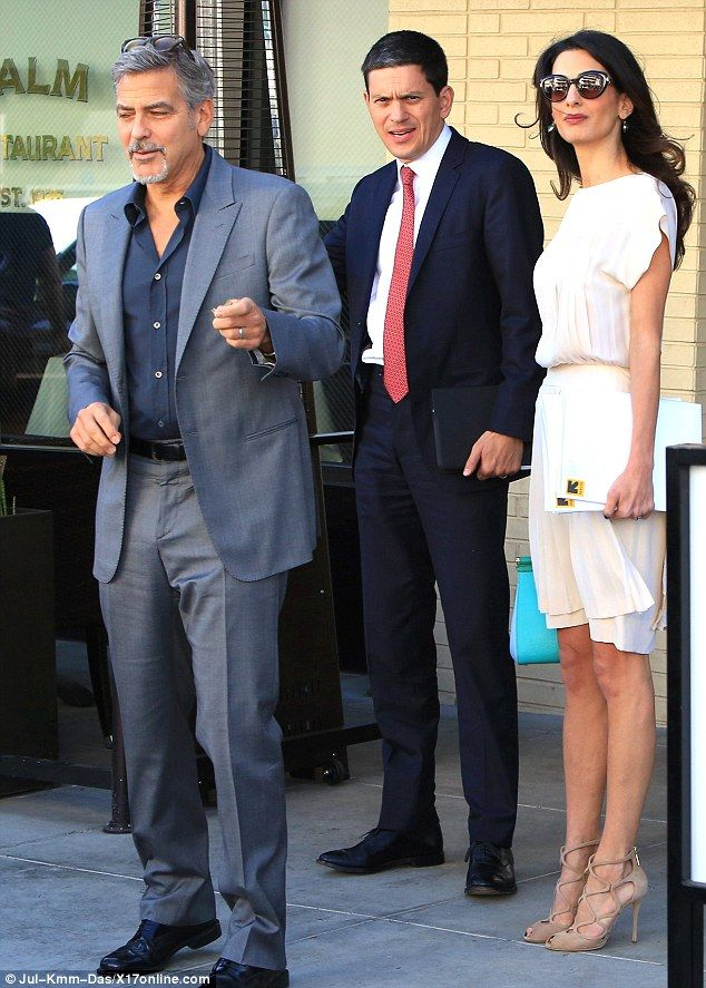 Power lunch: George and Amal Clooney dined withDavid Miliband in LA on Thursday