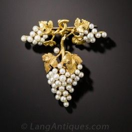 An oenophile's delight! Three lustrous clusters of white grapes, ready for harvest, comprise this fabulous, fun and festive brooch, artfully hand-fabricated in rich 18K yellow gold. Intoxicating! 1 3/8 by 1 3/8 inches.