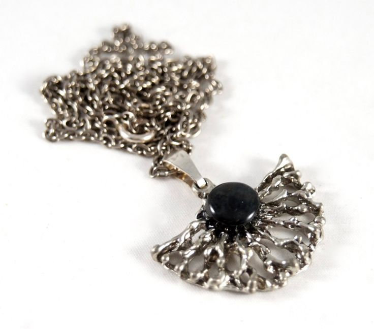 Tapani Vanhatalo (FI), organic modernist silver plated pewter necklace with a charcoal-black glass cabochon, 1960s. #finland | finlandjewelry.com #forsale