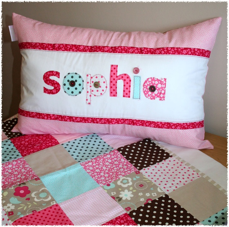 Patchwork style cot linen with customized name scatter made by Tula-tu Baby Linen