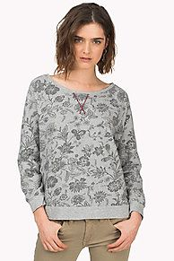 Inspired by retro sweatshirts, this super soft jumper stands out in a floral cotton jacquard. Hilfiger Denim heart charm above the bottom hem, flag on the sleeve. Flattering, wide boat neck with accent tape along the neckline. Straight, shorter styling that comes to the hips with raglan sleeves, sweatshirt V-embroidery at the front neckline, ribbed cuffs and bottom hem.<br/><br/>Our model is 1.76m and is wearing a size S Hilfiger Denim jumper.