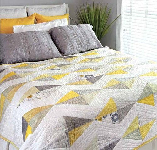 Designer Barbara Parsons Cartier has always loved quilts made up in soft colors, so she designed a modern quilt using half-rectangle triangles and fat quarters. This bed quilt measures 58 ¼