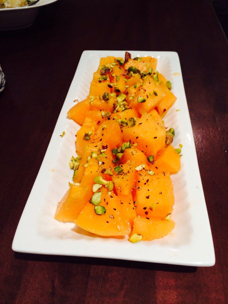 Sweet Melon topped with crushed pistachio nuts and served with a side of wasabi creme fraiche.