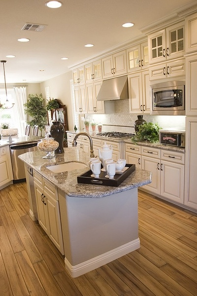 some i will have this kitchen.... the cabinets, counters, floor, colors...everything.- kitchen hood and micro wave idea