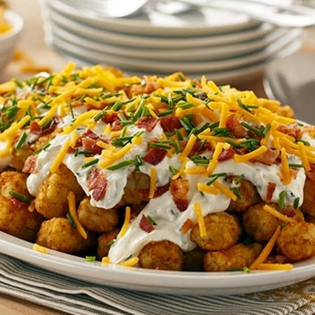 Loaded Totchos  --  Bake tater tots as directed on package.  Then top with a sour cream mixture, crumbled bacon, shredded cheddar,  and green onions.  Easy and delicious!