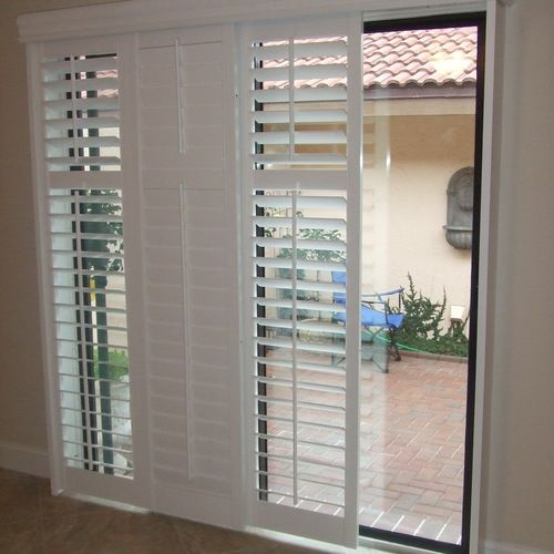 Sliding shutters modernize your sliding glass patio door and are a great alternative to vertical for Alternatives to exterior shutters
