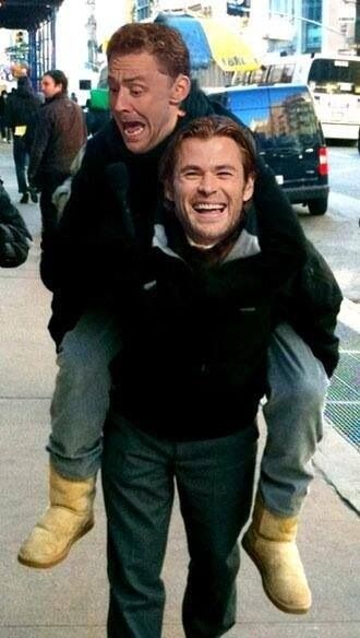 Not sure what part of this picture is best...Tom's boots, his face, or the fact that hes getting a pony ride from Chris.