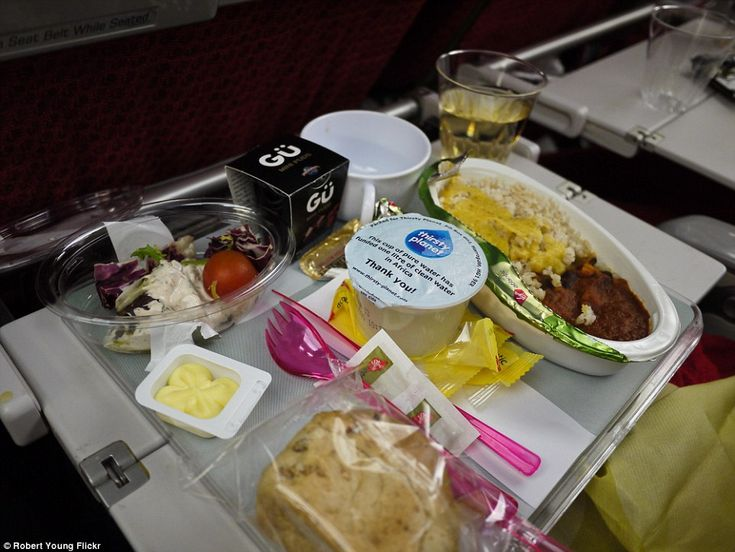 Garish plastic cutlery from Virgin Atlantic's economy flight meal sits uneasily next to an unidentifiable stew served with rice. There is also a salad with mayonnaise dressing and a bread roll. The best thing about this meal Gu chocolate dessert