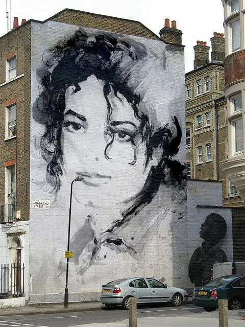 Michael Jackson. I like how the lamp post is his microphone in this picture. Great eye whoever shot this.