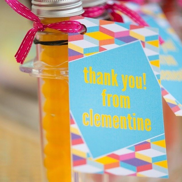 We love how simple and sweet a thank you can be. Like this one - Our gorgeous geometric thank you tag, tied to a tube of lollies with pretty pink ribbon. Easy! #partyideas #thankyou #kidsparties #geometric #lollies #personalised