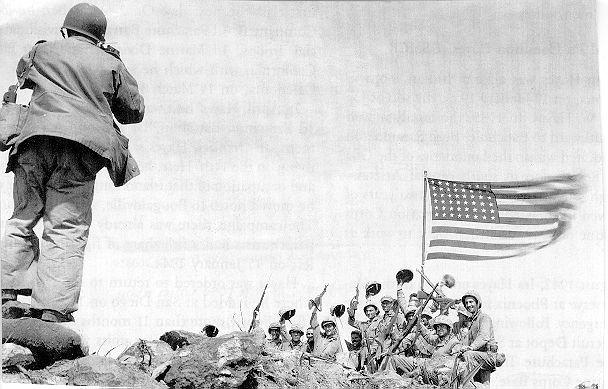 Joe Rosenthal taking a posed photo after the second Iwo Jima flag raising. www.workshopexperience.com