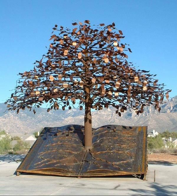 """""""The Tree of Knowledge"""" .. Bronze sculpture by Joe A. Tyler stands before the majestic Catalina Mountains and welcomes visitors at the Oro Valley Public Library entrance"""