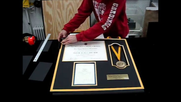 Our latest video demonstrating how we build certificate frames incorporating a medal and program guide.  Turned out fantastic.  We can make diploma and certificate frames for all occasions.