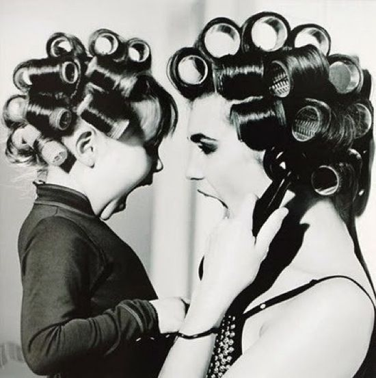 :)  mom always washed her hair once or twice a week and had the rollers in and then we had to go grocery shopping and she would put her blue crepe ribbon type scarf on!