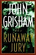 The Runaway Jury by John Grisham: The face of Nicholas Easter was slightly hidden by a display rack filled with slim cordless phones, and he was looking not directly at the hidden camera but somewhere off to the left, perhaps at a customer, or perhaps at a counter where a group...