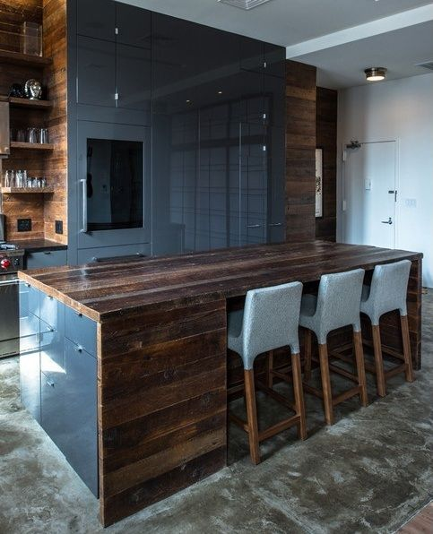Dark wood and lacquered grey kitchen cabinets