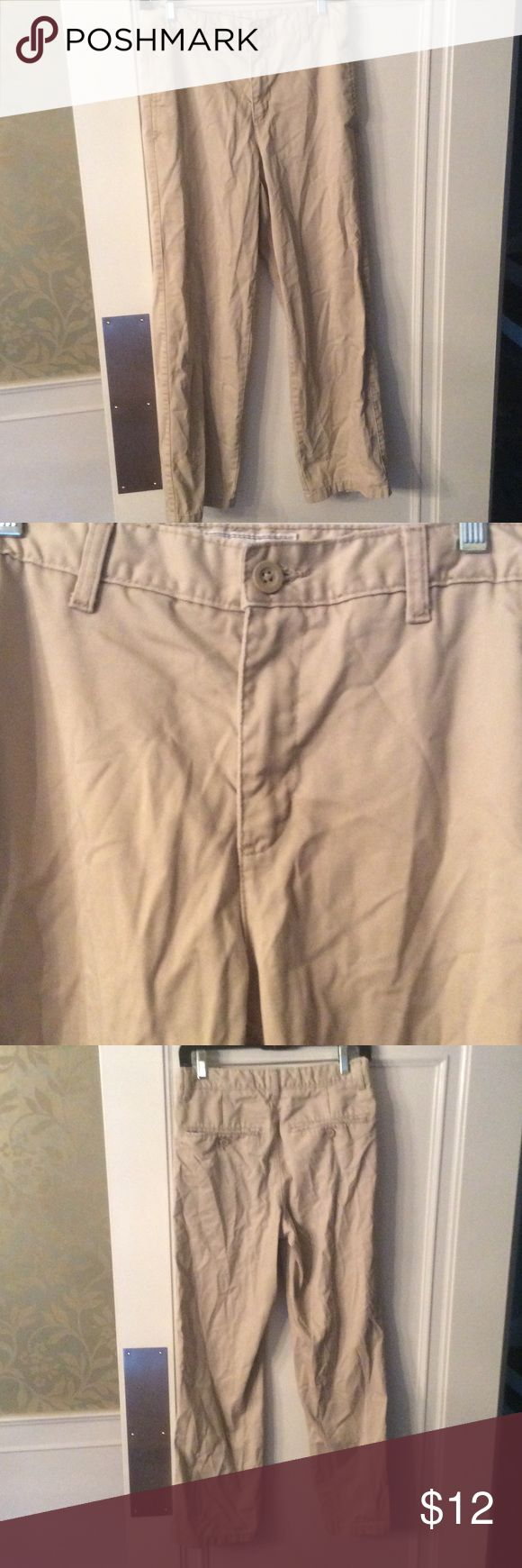Old Navy boy's plain front khaki pants Old Navy boy's plain front khaki pants with adjustable waist. In great condition just need a good ironing. My son wore them for school uniform pants and quickly outgrew them. Old Navy Bottoms Casual