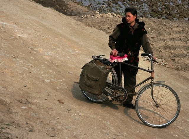 North Korea transportation use a lot of bikes to get around.