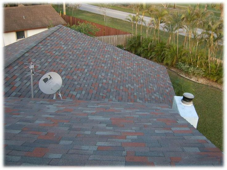 Dark, multi-color shingle roof blends best with light gray or blue homes.