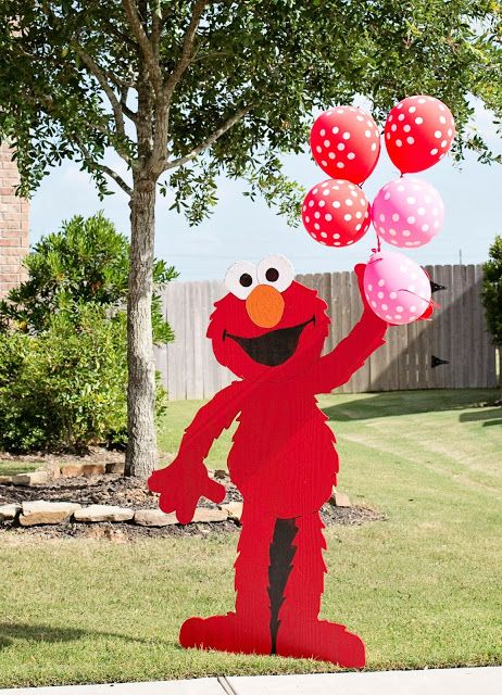 Elmo cut-out holding polka dots balloons makes the perfect greeting for kids. See more Elmo birthday party ideas at www.one-stop-party-ideas.com
