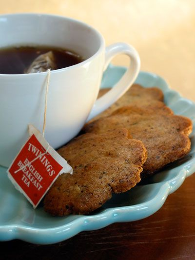 Earl Grey Tea Cookies  makes 2 dozen  1 cup all purpose flour   1/4 cup sugar   1/4 cup confectioners' sugar   1 tablespoon Earl Grey tea leaves*   1/4 teaspoon salt   1/2 teaspoon vanilla   1 teaspoon water  1/2 cup unsalted butter  Preheat oven to 375°F. Pulse together all the dry ingredients in a food processor until the tea leaves are pulverized.  Add vanilla, water, and butter. Pulse together until a dough is formed. Form the dough into a log onto a piece of wax or parchment paper. ...
