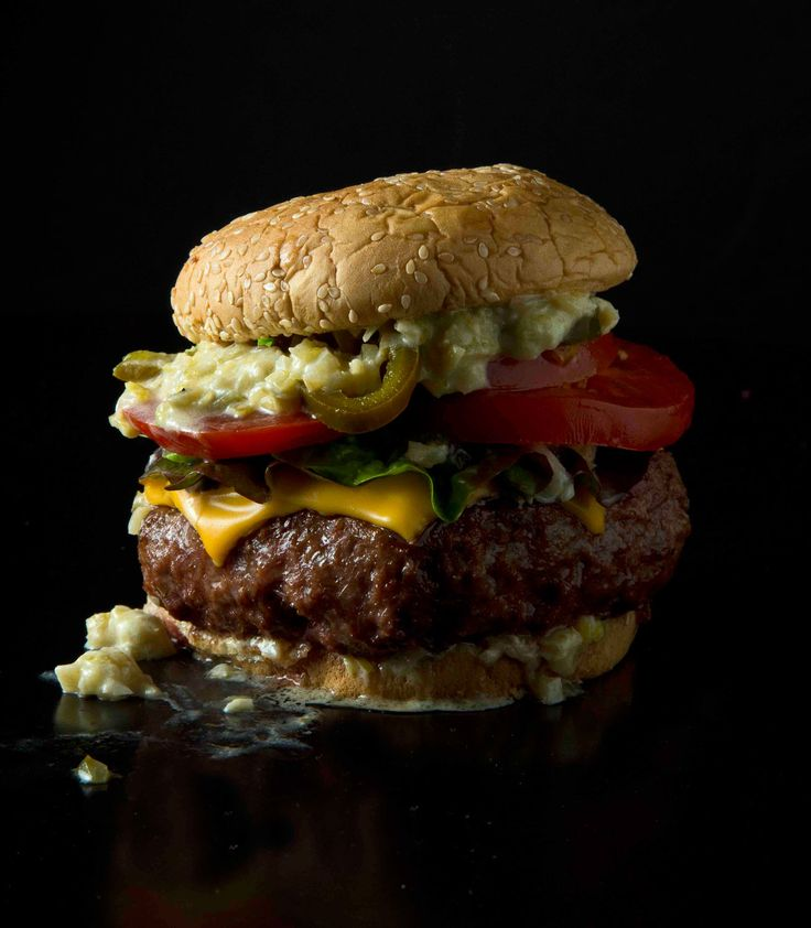Ultimate Grilled Cheeseburger-- This burger, inspired by one created in Modernist Cuisine co-author Nathan Myhrvold's culinary lab, is topped with a tangy cream and vermouth sauce. Adding egg yolks to freshly ground meat makes for a supremely rich burger.
