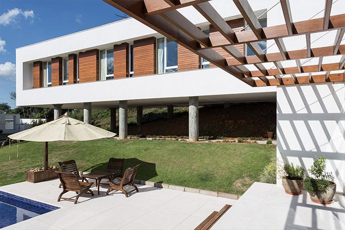 Spectacular lounge and pool outside cantilevered house in Erechim, Brazil featuring sustainable features