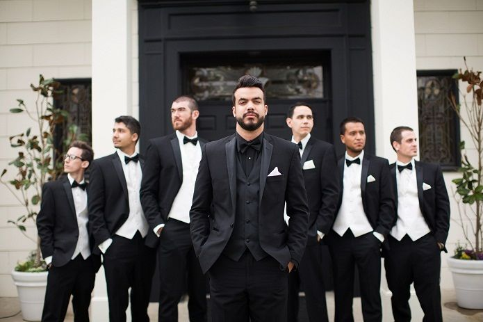 Classic black and white wedding. Make the groom stand out by wearing an all black tuxedo look with the groomsmen in black and white. Full gallery: https://www.friartux.com/blog/7854#.VbKw17NVhBc