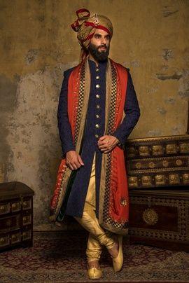 Groom Wear - Blue Sherwani | WedMeGood Indigo Blue Sherwani with Gold Buttons, Gold Churidar, Orange Chunni with Black and Gold Border and Gold and Red Safa! Ideal Wedding Sherwani! #wedmegood #groomwear