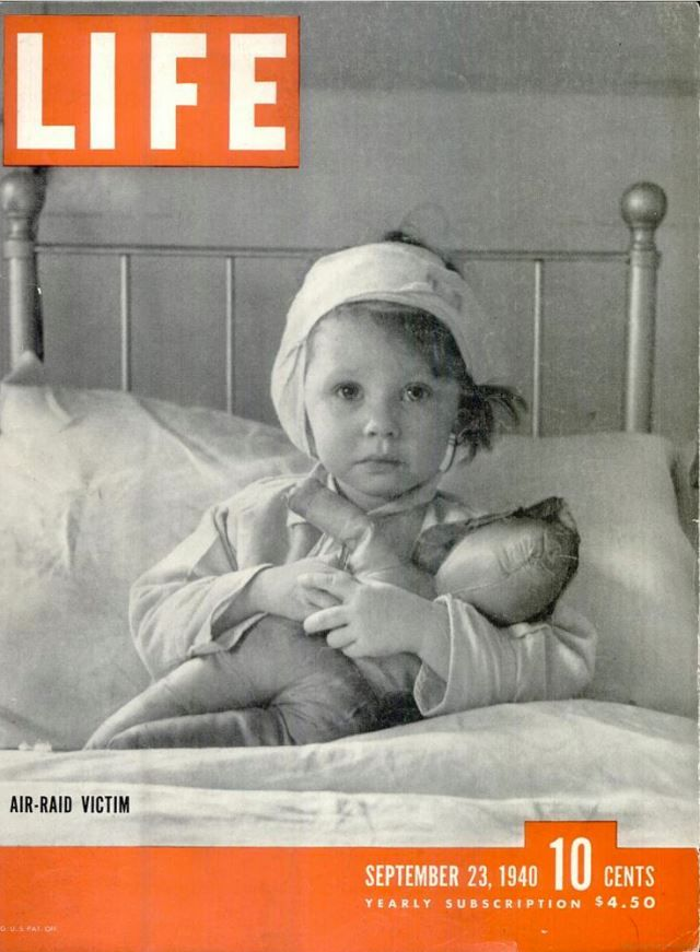"""Life Magazine: """"The wide-eyed young lady on the cover is Eileen Dunne, aged 3 3/4. A Geman bomber whose crew had never met her dropped a bomb on a Northern England village. A splinter from it hit Eileen. She is sitting in the hospital. A plucky chorus of wounded children had just finished singing in a North English dialect, """"Roon, Rabbit, Roon."""" Photo credit: Cecil Beaton"""